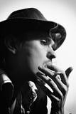 Portrait of a young  smoking man Stock Photos