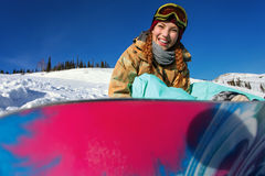 Portrait of young snowboarder girl Stock Photos