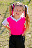 Portrait of young soccer girl on the field during a game. Soccer girl with pink and black jersey during a game Royalty Free Stock Photography