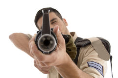 Portrait of young soldier aiming Royalty Free Stock Photography
