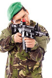 Portrait of a young soldier aiming with a gun Stock Photos