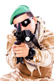 Portrait of a young soldier aiming with a rifle. Isolated on white Royalty Free Stock Photography