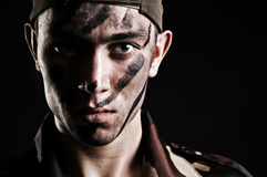 Portrait of young soldier in camouflage Stock Photo