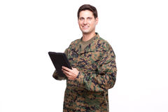 Portrait of a young soldier with a digital tablet Royalty Free Stock Images