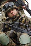Portrait of young soldier with gun Stock Photos