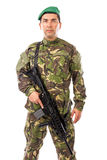 Portrait of a young soldier with a gun Stock Photo