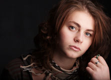Portrait of young sorrowful girl Stock Photo