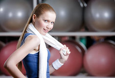 Portrait of a young sportive girl with towel Stock Images