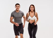 Two fit runners. Portrait of young sportive happy healthy couple running royalty free stock photography