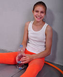 Portrait of young sportive teen girl with a bottle of drinking water Royalty Free Stock Photo