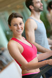 Portrait of a young sportive woman with her boyfriend in a fitness club Stock Photography
