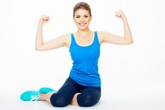 Portrait of young sports woman on isolated white background Stock Photo