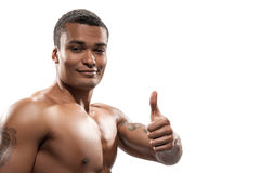 Portrait of young sportsman showing signs Royalty Free Stock Photos