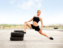 Portrait of Young Sporty Girl Doing Exercise. Front Splits Royalty Free Stock Photo