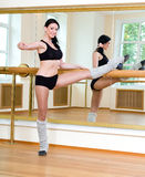 Sporty girl doing physical exercise Stock Photo