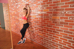 Portrait of young sporty girl doing stretching exercise Royalty Free Stock Images
