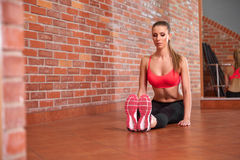 Portrait of young sporty girl doing stretching exercise Stock Photography