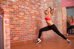 Portrait of young sporty girl doing stretching exercise Royalty Free Stock Photos