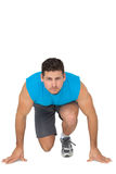 Portrait of a young sporty man in running stance Royalty Free Stock Photo