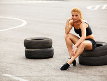 Portrait of Young Sporty Woman Doing Stretching Exercise. Athlet Royalty Free Stock Photos