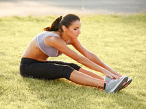 Portrait of Young Sporty Woman Doing Stretching Exercise. Athlet Stock Photo