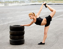 Portrait of Young Sporty Woman Doing Stretching Exercise. Athlet Stock Photos