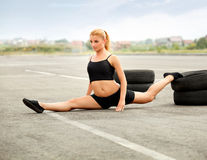 Portrait of Young Sporty Woman Doing Stretching Exercise. Athlet Royalty Free Stock Images