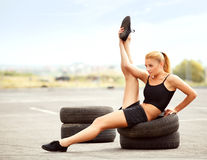 Portrait of Young Sporty Woman Doing Stretching Exercise. Royalty Free Stock Image