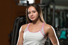 Portrait Of A Young Sporty Woman In Gym Royalty Free Stock Photos