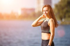 Portrait of young sporty woman resting after jog Stock Photo