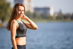 Portrait of young sporty woman resting after jog Stock Photography