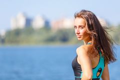 Portrait of young sporty woman resting after jog Royalty Free Stock Images