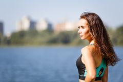Portrait of young sporty woman resting after jog Royalty Free Stock Photos
