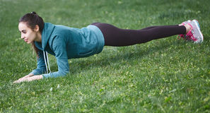 Portrait of young and sporty woman in sportswear doing yoga or Stretching exercises Stock Photography