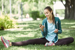 Portrait of young and sporty woman in sportswear doing yoga or Stretching exercises Stock Photo