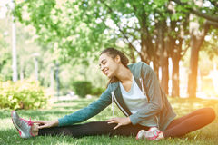 Portrait of young and sporty woman in sportswear doing yoga or Stretching exercises Stock Images