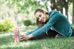 Portrait of young and sporty woman in sportswear doing yoga or Stretching exercises Royalty Free Stock Photography
