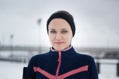 Portrait of young sporty woman at winter snow outdoor, close up. Telephoto Stock Images