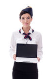 Portrait of young stewardess showing laptop with blank screen is Royalty Free Stock Image