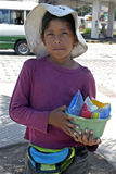 Portrait of young street vendor in the city Santa. Bolivia: closeup of Bolivian boys that try to earn money, income, in the street between cars or by the petrol Stock Photos
