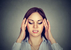 Portrait of a young stressed woman with headache. Portrait of a stressed woman with headache Royalty Free Stock Photography