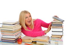 Portrait of young student girl with lots of books Royalty Free Stock Images