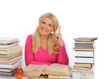 Portrait of young student girl with lots of books Royalty Free Stock Photography