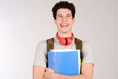Portrait of young student holding notebook. White background Stock Image