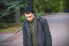Portrait of young stylish man with bag in the street Royalty Free Stock Image