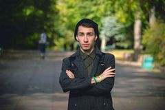 Portrait of young stylish man with bag in the street Royalty Free Stock Images