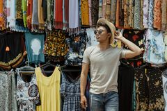 Young stylish man pose in front of the souvenir shop stock image