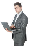 Portrait of young success businessman with laptop Stock Images