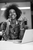 Portrait of a young successful African-American woman in modern. Portrait of a young successful African American beautiful woman who enjoys spending a quality Royalty Free Stock Image