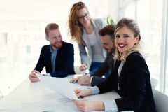 Portrait of young architect woman on meeting royalty free stock image
